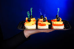 A waiter with a tray of canapes Stock Image