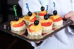 A waiter with a tray of canapes Stock Photo