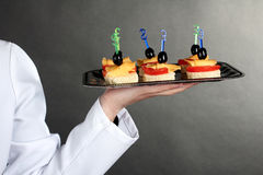 A waiter with a tray of canapes Royalty Free Stock Photography