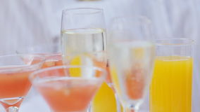 A waiter with a tray of glasses of champagne, delicious apple punch.  stock footage
