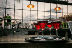 Red cocktail drinks on a bar counter stock photography
