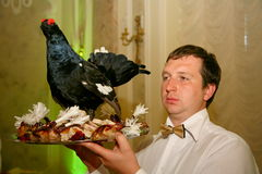 The waiter with the tray in a Russian restaurant. Stock Photos