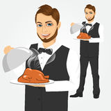 Waiter with tray serving roasted poultry Stock Photography