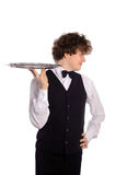 Waiter with tray. Young handsome waiter with tray, isolated on white Royalty Free Stock Image