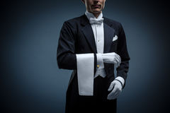 Waiter. In a tuxedo on a black background Stock Photography