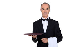 Waiter in tuxedo. Holding a plate Royalty Free Stock Photo
