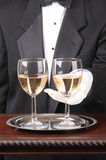 Waiter With Two Glasses of Chardonnay Stock Photo