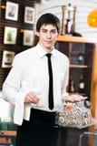 Waiter in uniform at restaurant. Handsome man waiter in uniform at restaurant stock photography