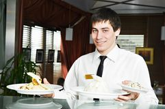 Waiter in uniform at restaurant Royalty Free Stock Photography