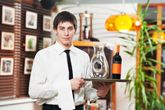 Waiter in uniform at restaurant Stock Image