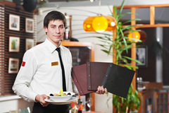 Waiter in uniform at restaurant Stock Image