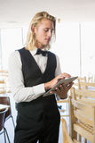 Waiter using digital tablet in restaurant Royalty Free Stock Photography
