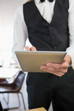 Waiter using digital tablet in restaurant Stock Photos