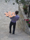 A waiter. View of a waiter serving someone who has many plates with a lot of canapes covered with red caviare on the tray Stock Photography