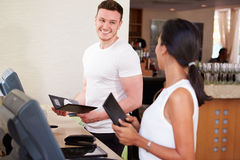 Waiter And Waitress In Hotel Restaurant Preparing Bill Royalty Free Stock Image