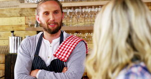 Waiter and waitress interacting with each other stock footage