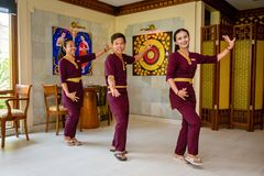 Waiter and waitress in the thai restaurant performing dance. Waiter and waitress wearing uniform in the thai restaurant performing dance stock photos