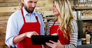 Waiter and waitress using digital tablet stock footage