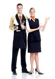 Waiter and waitress. Young  smiling waiter and waitress. Isolated over white background Royalty Free Stock Images