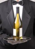 Waiter with White Wine Bottle Blank Label royalty free stock photo