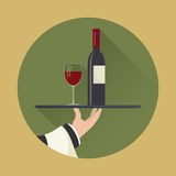 Waiter with wine bottle and wine glass Royalty Free Stock Images