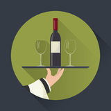Waiter with wine bottle and wine glasses Royalty Free Stock Photo