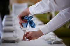 The waiter wipe glasses for wine Royalty Free Stock Photography