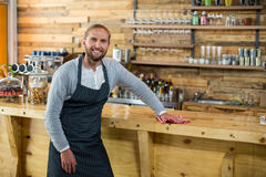 Waiter wiping counter with napkin in café Royalty Free Stock Images