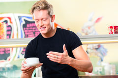 Waiter working in ice cream cafe Royalty Free Stock Photo