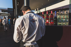 Waiter working on Martini terrace at Expo 2015 in Milan, Italy Royalty Free Stock Images