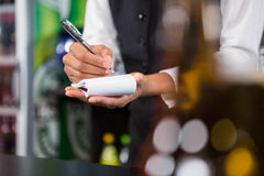 Waiter writing down an order Royalty Free Stock Image