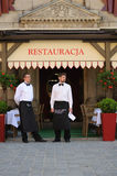 Waiters. In front of the restaurant on the market square - Wroclaw - Poland Royalty Free Stock Photos