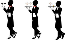 Waiters. Three wiaters in formal attire carrying drinks on trays Stock Photo