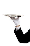 Waiters Arm holding a serving tray Royalty Free Stock Image