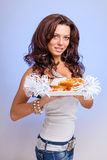 Waiters carrying hold  plates with meat on blue Royalty Free Stock Photo
