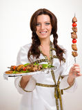 Waiters carrying plates with meat on white Stock Photos