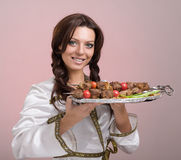 Waiters carrying plates with meat Royalty Free Stock Photos