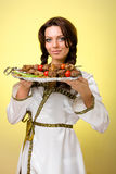Waiters carrying plates with meat on yellow Royalty Free Stock Photos