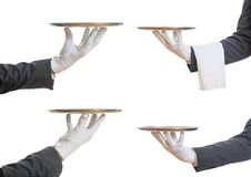 Waiters hands holding trays Stock Images