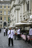 Waiters outside cafes, piazza navona, Rome Stock Photography