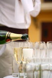 Waiters poured champagne Royalty Free Stock Image