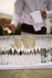 Waiters poured champagne Stock Images