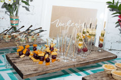 Waiters poured into glasses of wine and champagne Stock Photos