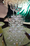 Waiters poured into glasses of wine and champagne Royalty Free Stock Images