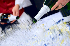 Waiters are pouring champagne Stock Photo