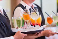 Waiters with serving tray. Aiters with serving tray and colorful drink on it stock photo