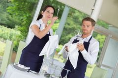 Waiters setting tables at gastronomy restaurant Stock Photography
