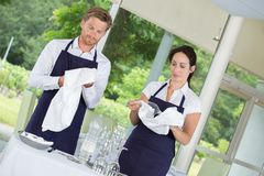2 waiters setting up restaurant tables stock photo