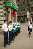 Waiters standing in line in front of a restaurant in Shanghai Stock Images