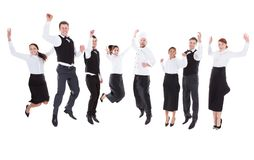Waiters and waitresses jumping Stock Images